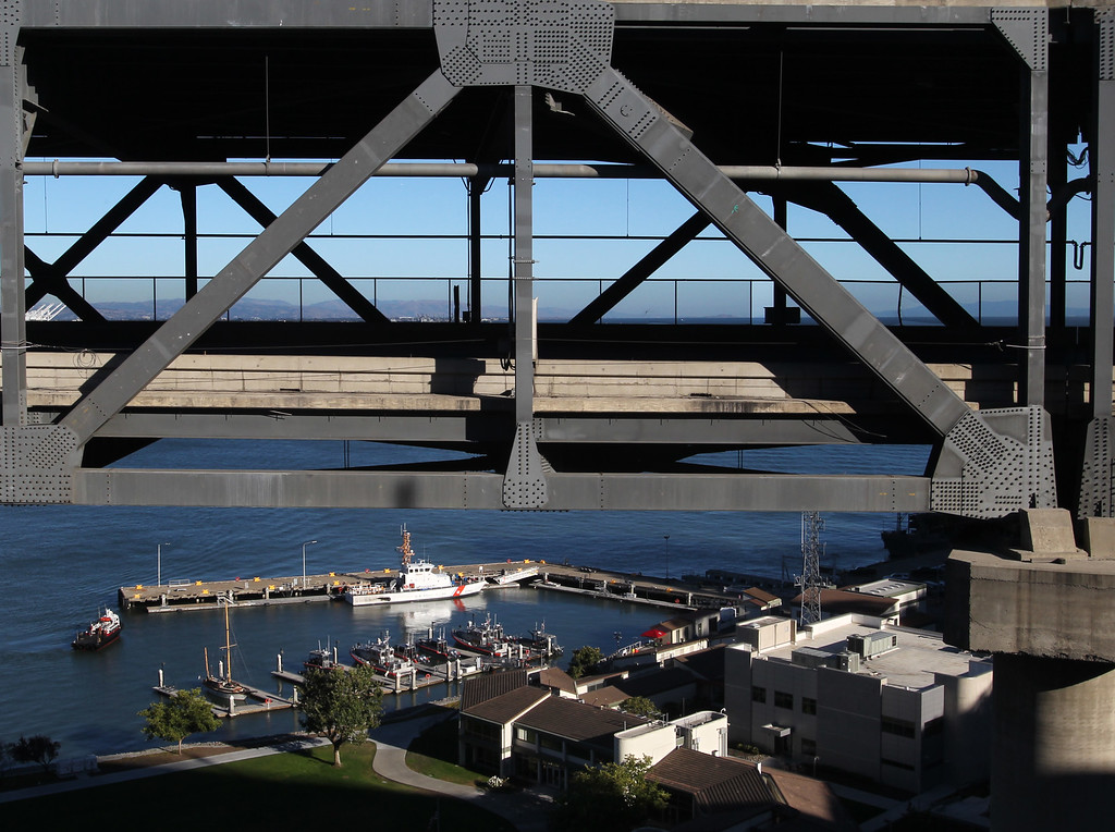 . A segment of the old eastern span of the Bay Bridge is seen atop the U.S. Coast Guard station at Treasure Island in San Francisco, Calif., on Thursday, Aug. 30, 2013.  (Ray Chavez/Bay Area News Group)