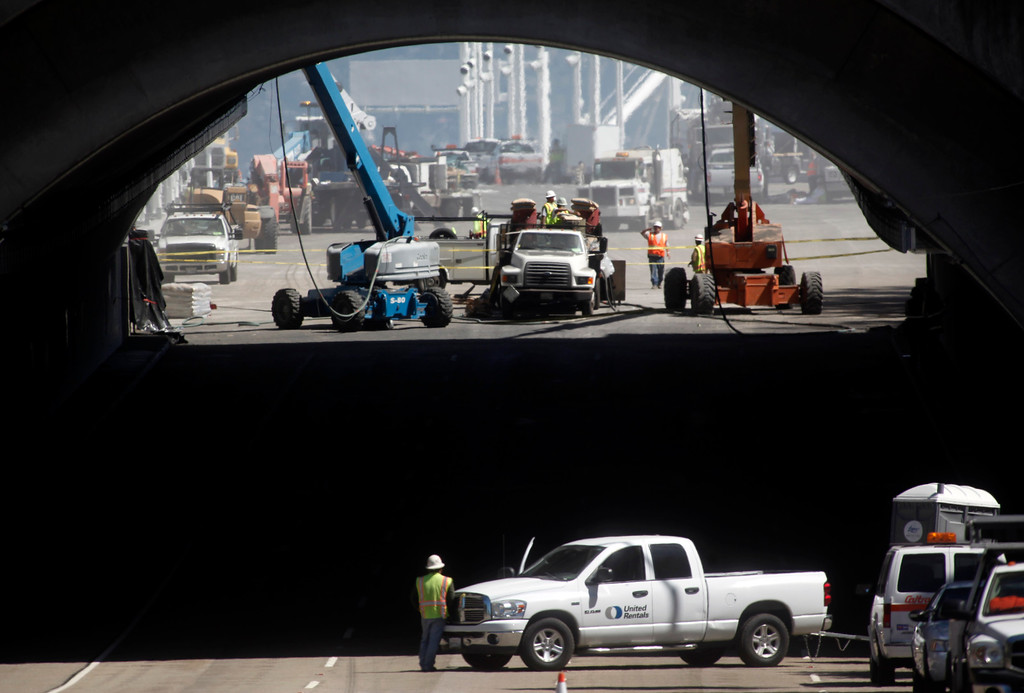 . A lone construction worker watches crews on the east side of the Yerba Buena tunnel preparing the new Bay Bridge eastern span on Friday morning, Aug. 30, 2013, in San Francisco, Calif. (Karl Mondon/Bay Area News Group)