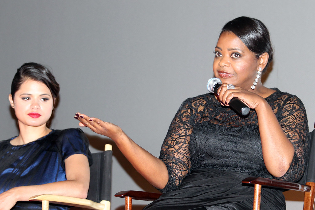. Fruitvale Station cast Melonie Diaz, left, who plays the role as Oscar Grant\'s girlfriend, and Octavia Spencer as his mother, take part in a questions and answers following the private screening of the award winning film at the Grand Lake Theater in Oakland, Calif., on Thursday, June 20, 2013.  The film chronicles the last hours of Oscar Grant\'s life before he was shot and killed on New Year\'s Eve 2009. (Ray Chavez/Bay Area News Group)