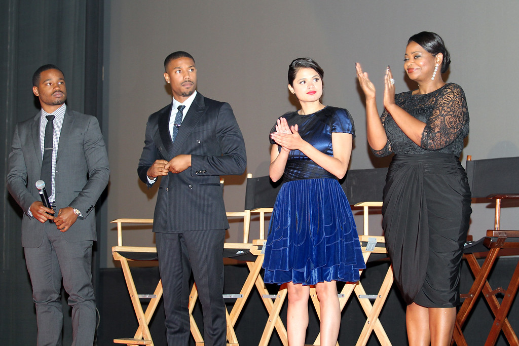 . Fruitvale Station film director Ryan Coogler, left, and the cast, Michael B. Jordan, who plays the role as Oscar Grant, Melonie Diaz as his girlfriend and Octavia Spencer as his mother acknowledge friends and family members of Grant after a questions and answers following the private screening of the award winning film at the Grand Lake Theater in Oakland, Calif., on Thursday, June 20, 2013.  The film chronicles the last hours of Oscar Grant\'s life before he was shot and killed on New Year\'s Eve 2009. (Ray Chavez/Bay Area News Group)