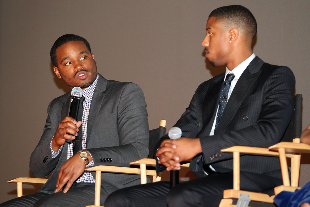 . Fruitvale Station film director Ryan Coogler, left, speaks as actor Michael B. Jordan, who plays the role as Oscar Grant, looks during a questions and answers following the private screening of the award winning film at the Grand Lake Theater in Oakland, Calif., on Thursday, June 20, 2013.  The film chronicles the last hours of Oscar Grant\'s life before he was shot and killed on New Year\'s Eve 2009. (Ray Chavez/Bay Area News Group)