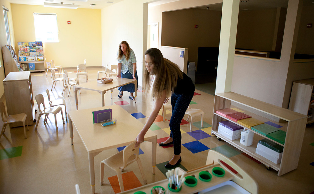 . Teachers Lynda Sutton, left, and Mary Cheline set up their classroom at the Harker School\'s new preschool in San Jose Wednesday, July 31, 2013. The school opens in September. (Patrick Tehan/Bay Area News Group)