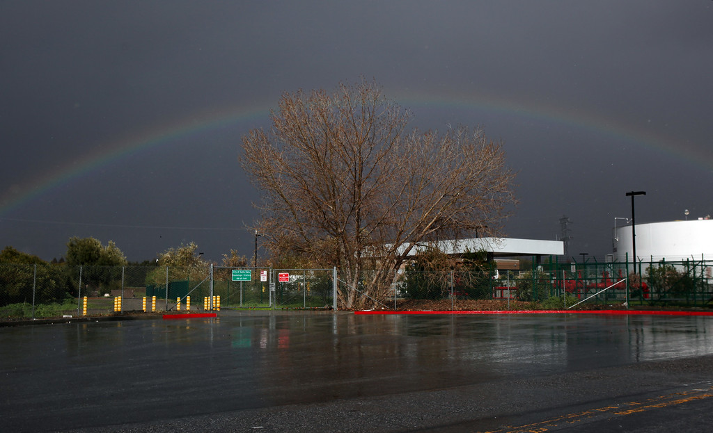 . A short-lived rainbow appears  Friday afternoon, Feb. 28, 2014, near a fuel facility at San Jose International Airport in San Jose, Calif. (Karl Mondon/Bay Area News Group)