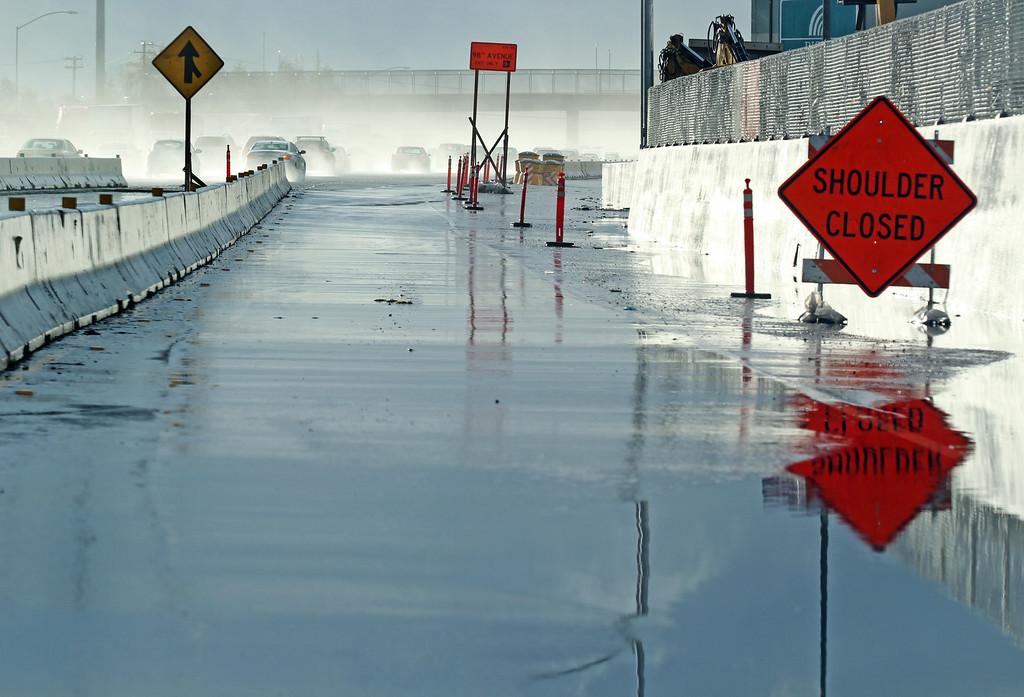 . A flooded shoulder closed part of the onramp to southbound Interstate 880 at Hegenberger Road in Oakland, Calif., on Friday, Feb. 28, 2014.(Laura A. Oda/Bay Area News Group)