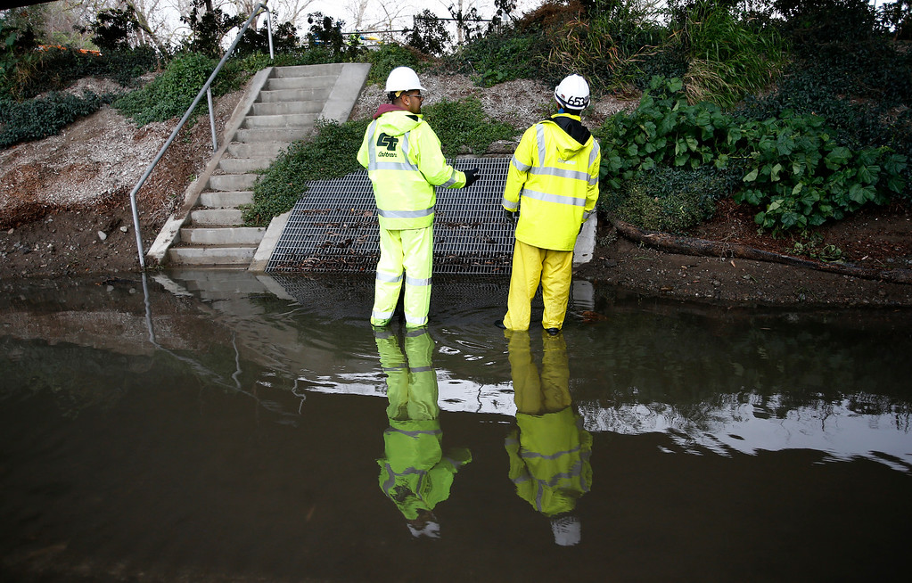 . CalTrans workers try to clear out flooding on southbound Highway 87, the Guadalupe Parkway, beneath Taylor Avenue in San Jose, Calif. on Friday, Feb. 28, 2014. Two lanes were blocked. Heavy rain prompted flooding and wind advisories in the Bay Area. (Gary Reyes/Bay Area News Group)