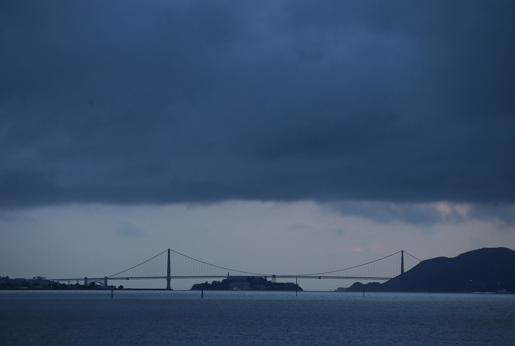 . Storm clouds hover over the Golden Gate Bridge shortly after sunset in this view across the bay from West Frontage Road in Emeryville, Calif., on Friday, Feb. 27, 2014. More showers are expected on Saturday according to the National Weather Service. (Jane Tyska/Bay Area News Group)