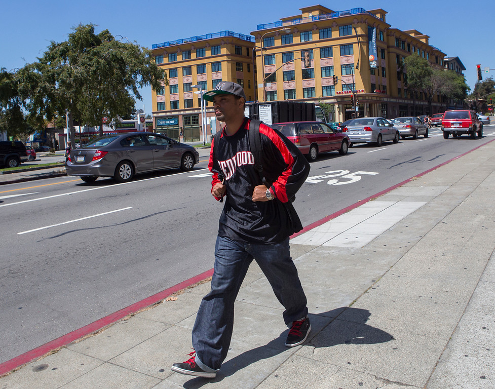 """. Gary \""""Malachi\"""" Scott, walking in Berkeley on Aug. 23, 2013, left San Quentin this past June, having been granted parole in December 2012. He\'s decided to stay in the Bay Area to avoid the negative influences of his old life in Southern California. Scott, who was the sports editor for San Quentin\'s monthly newspaper, hopes one day to land a job in journalism. He also plans to work with at-risk teenagers. \""""I want to work with the kids that are at the turning point,\"""" he says, \""""where they could make a bad decision, but show them there\'s other options, that their bad decisions will have impacts on others.\"""" (John Green/Bay Area News Group)"""