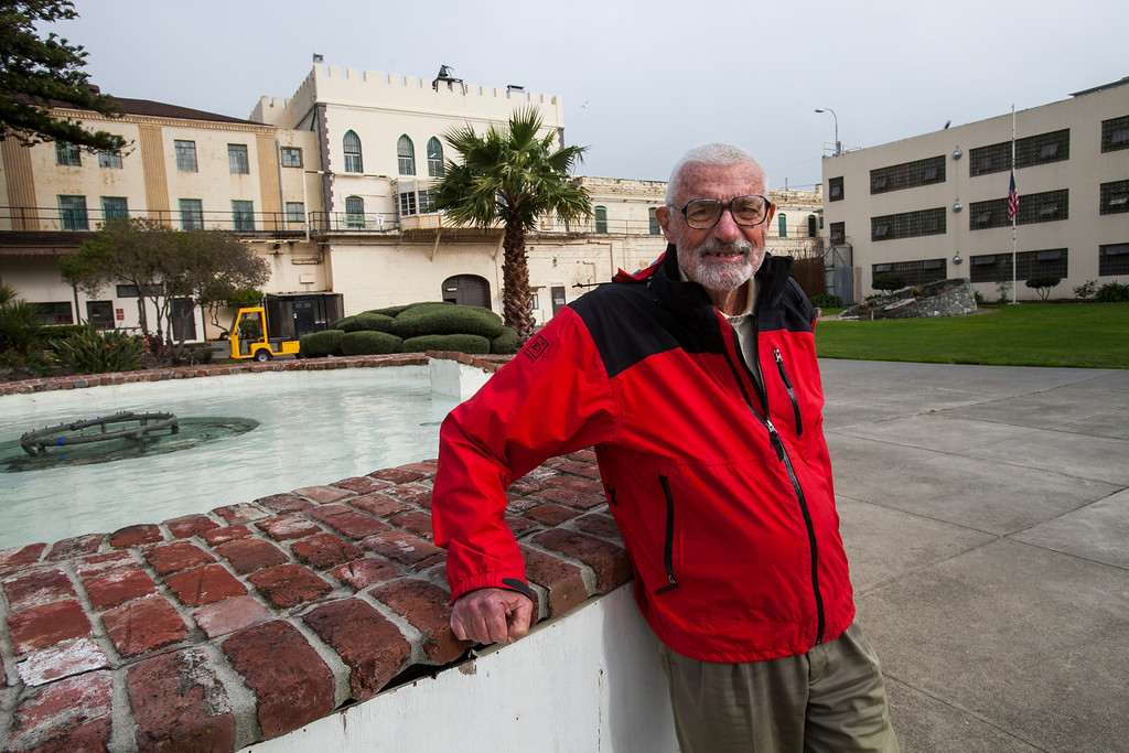 """. John Kelly, former executive director of nonprofit Samaritan House in San Mateo County, stands in the courtyard at San Quentin in 2012. Kelly is one of several volunteers who have worked with Kid CAT. \""""I respect who they\'ve become,\"""" he says of the group, \""""and how they\'ve worked to get themselves to the place of being decent human beings.\"""" (John Green/Bay Area News Group)"""