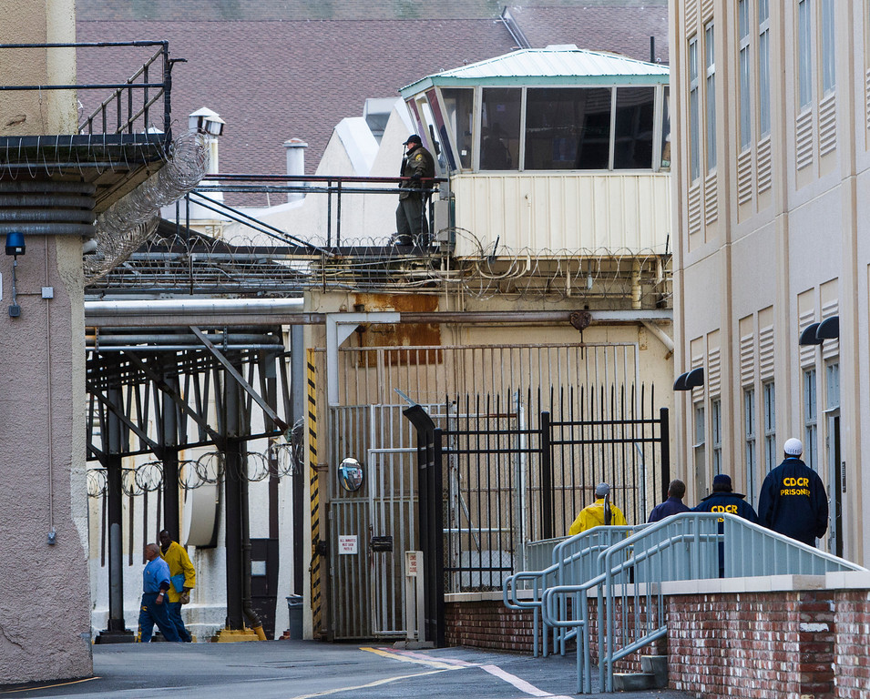 """. Prisoners walk near the entrance to North Block above San Quentin\'s recreation yard. Juvenile justice reformers in California are pushing to give some youthful offenders earlier, better opportunities for parole. But not all Californians embrace these changes. Phyllis Loya, an East Bay advocate for the National Organization of Victims of Teenage Offenders, says the idea that teenagers are immature and susceptible to peer pressure only goes so far. \""""Maybe you went out and stole a six-pack or took a car for a joyride,\"""" she says. \""""But shooting or stabbing someone is not a simple mistake. It is a vicious crime.\"""" (John Green/Bay Area News Group)"""