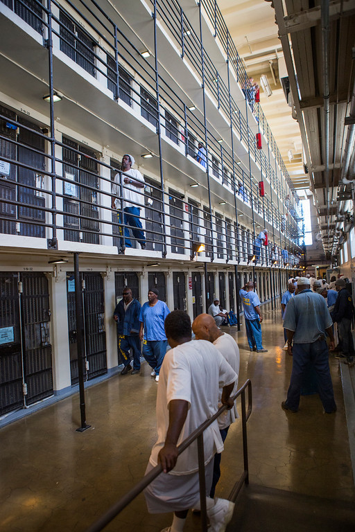 . Inmates mingle in the five-level North Block. The roughly 2,200 inmates who make up San Quentin\'s general population spend much of the day out of their cells, working or taking classes. (John Green/Bay Area News Group)