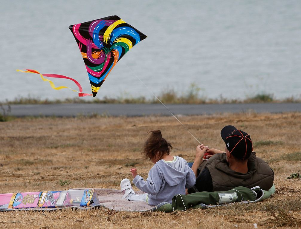 . Michael Scripps and his daughter Aurora, 5, fly a kite at Oyster Point Marina and Park in South San Francisco, Calif., on Saturday, Sept. 14,  2013. (John Green/Bay Area News Group)