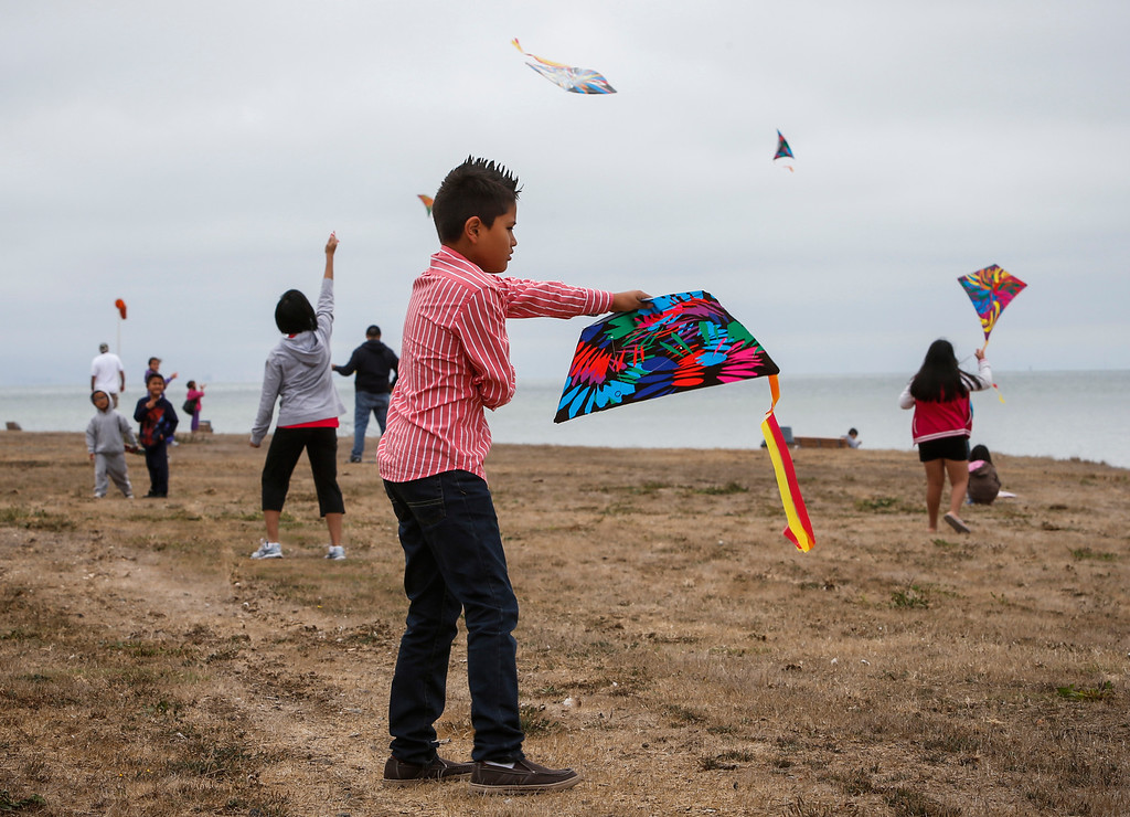 . Max Lara, 9, tries to get his kite up at Oyster Point Marina and Park in South San Francisco, Calif., on Saturday, Sept. 14,  2013. (John Green/Bay Area News Group)