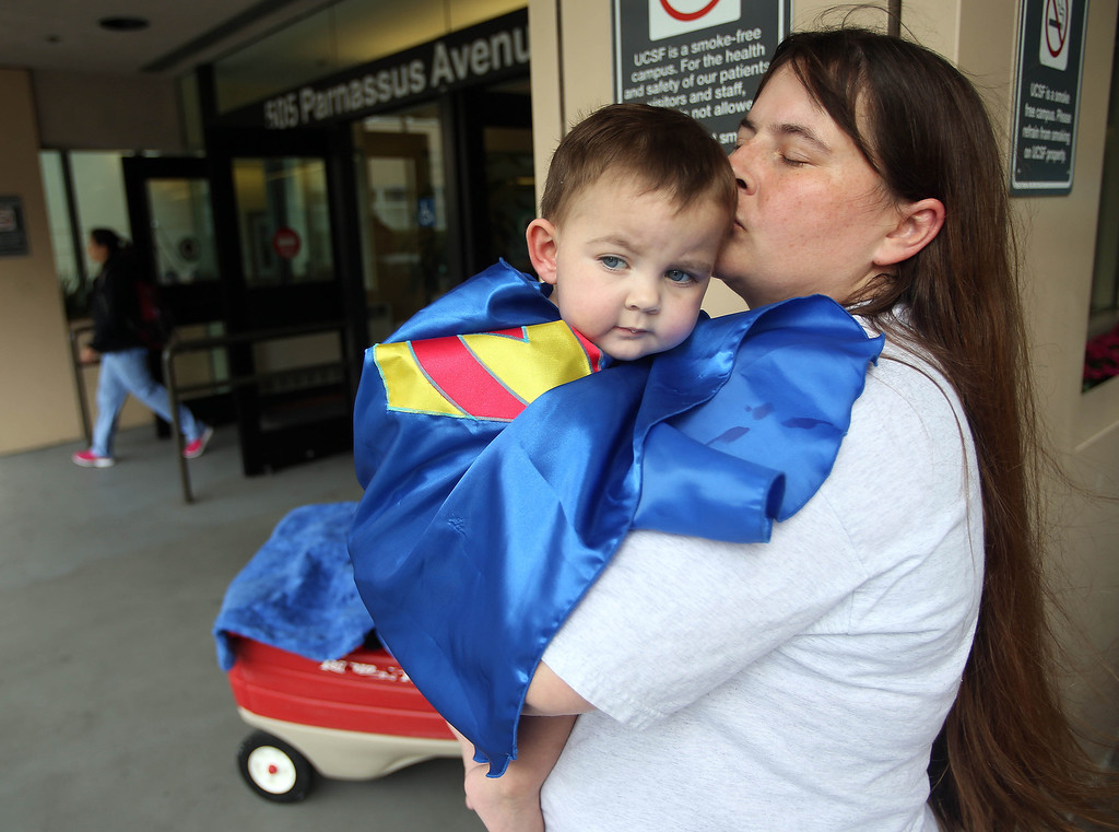". Kristi Ouimet, of Antioch, kisses her son Matthew, 2, after he was discharged from the UCSF Benioff Children\'s Hospital in San Francisco Calif., on Wednesday, Aug. 14, 2013. Matthew wore a superhero cape with an ""M\"" on the back, one of the many gifts he received while in the hospital. Matthew spent 73 days at UCSF after undergoing a liver/kidney transplant on June 4. (Jane Tyska/Bay Area News Group)"