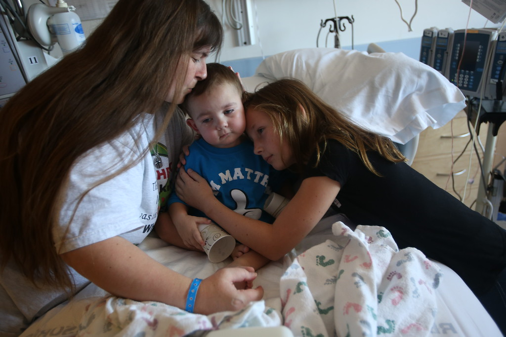 . Kristi Ouimet, of Antioch, left, and her daughter Molly, 10, right, comfort her son Matthew, 2, as he\'s about to be discharged from the UCSF Benioff Children\'s Hospital in San Francisco Calif., on Wednesday, Aug. 14, 2013.  Matthew spent 73 days at UCSF after undergoing a liver/kidney transplant on June 4. (Jane Tyska/Bay Area News Group)