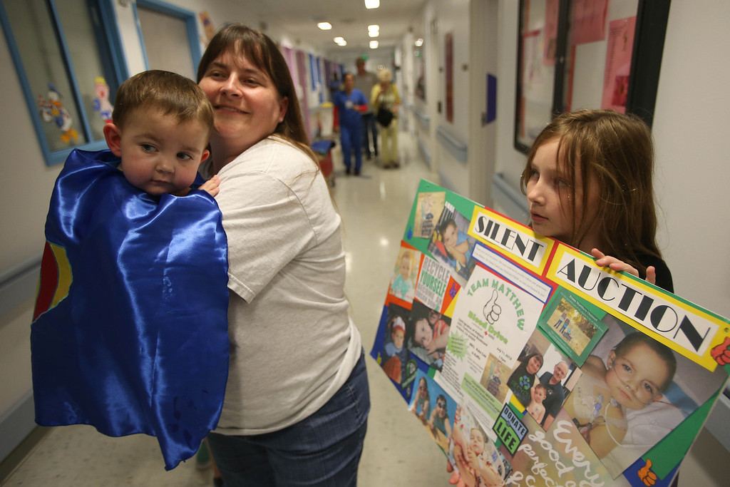 ". Kristi Ouimet, of Antioch, leaves with her son Matthew, 2, after he was discharged from the UCSF Benioff Children\'s Hospital in San Francisco Calif., on Wednesday, Aug. 14, 2013. To the right is her daughter Molly, 10. Matthew wore a superhero cape with an ""M\"" on the back, one of the many gifts he received while in the hospital. Matthew spent 73 days at UCSF after undergoing a liver/kidney transplant on June 4. (Jane Tyska/Bay Area News Group)"