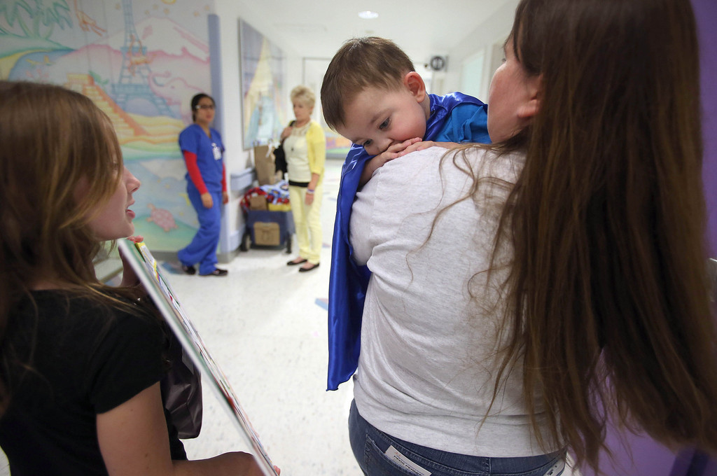 ". Kristi Ouimet, of Antioch, right, leaves with her son Matthew, 2, after he was discharged from the UCSF Benioff Children\'s Hospital in San Francisco Calif., on Wednesday, Aug. 14, 2013. To the left is Kristi\'s daughter Molly Ouimet, 10.  Matthew wore a superhero cape with an ""M\"" on the back, one of the many gifts he received while in the hospital. Matthew spent 73 days at UCSF after undergoing a liver/kidney transplant on June 4. (Jane Tyska/Bay Area News Group)"