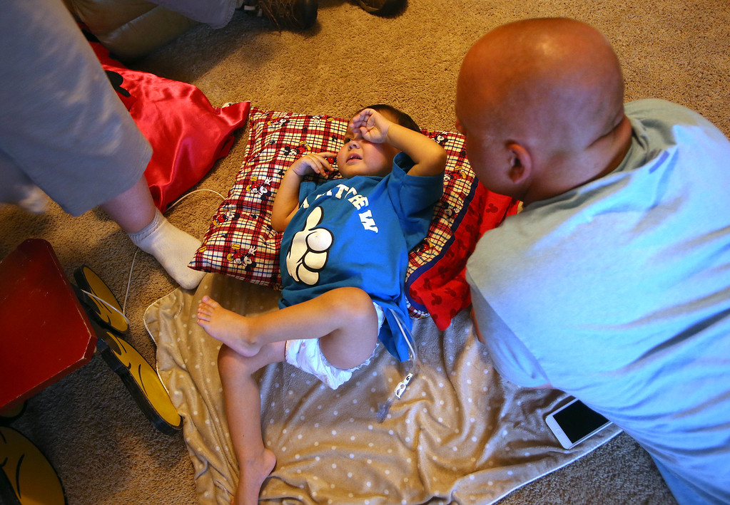 . Jimmy Wisecarver, right, of Brentwood, spends time with his nephew Matthew, Ouimet, 2, at the Ouimet\'s home in Antioch, Calif., on Wednesday, Aug. 14, 2013. Matthew was tired after being discharged from the UCSF Benioff Children\'s Hospital in San Francisco Wednesday, after spending 73 days there recovering from a liver/kidney transplant on June 4. (Jane Tyska/Bay Area News Group)