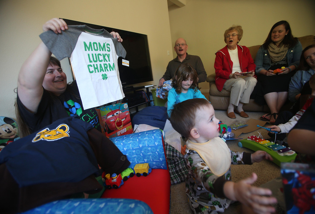 . Kristi Ouimet, left, and her son Matthew, 2, center, open presents as they celebrate his birthday with family and friends at their home in Antioch, Calif., on Sunday, Feb. 10, 2013. Matthew, who suffers from primary hyperoxaluria type 1, a rare liver disease, turned two on Feb. 11. He undergoes dialysis six times a week at the UCSF Medical Center in San Francisco, and is on the transplant list awaiting a liver and kidneys. (Jane Tyska/Staff)