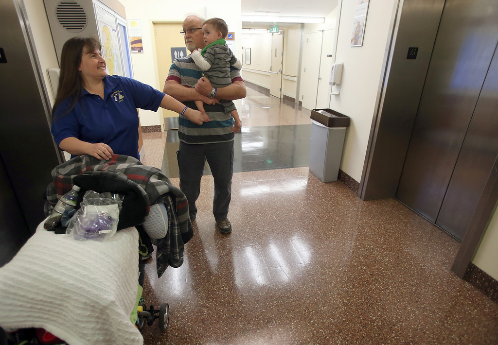 . Kristi Ouimet, of Antioch, with her dad Jim Wisecarver and her son Matthew, 23 months, prepare to visit with their friend Alyssa Welch, 15, of Riverbank, Calif., at UCSF Benioff Children\'s Hospital in San Francisco, Calif., on Tuesday, Jan. 22, 2013. Matthew is still awaiting both a liver and kidney transplant and does hemodialysis at UCSF Medical Center six times per week. (Jane Tyska/Staff)