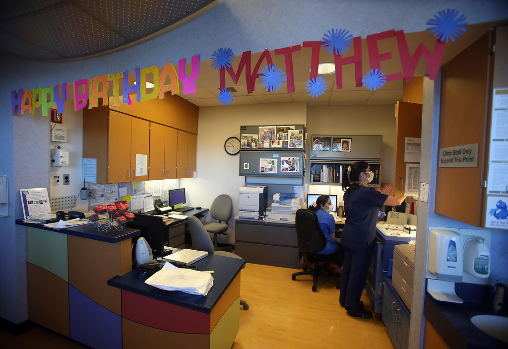 . A happy birthday sign adorns the nurse\'s station in the pediatric dialysis unit as Matthew Ouimet, 2, of Antioch, celebrates his birthday with family while undergoing dialysis at the UCSF Medical Center in San Francisco, Calif., on Monday, Feb. 11, 2013. Matthew, who suffers from primary hyperoxaluria type 1, a rare liver disease, turned two on Feb. 11. He undergoes dialysis six times a week and is on the transplant list awaiting a liver and kidneys. (Jane Tyska/Staff)