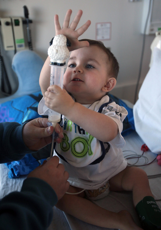 . Matthew Ouimet, 2, puts a toy sheep on top of his feeding tube as he celebrates his birthday with family while undergoing dialysis at the UCSF Medical Center in San Francisco, Calif., on Monday, Feb. 11, 2013. Matthew, who suffers from primary hyperoxaluria type 1, a rare liver disease, turned two on Feb. 11. He undergoes dialysis six times a week and is on the transplant list awaiting a liver and kidneys. (Jane Tyska/Staff)
