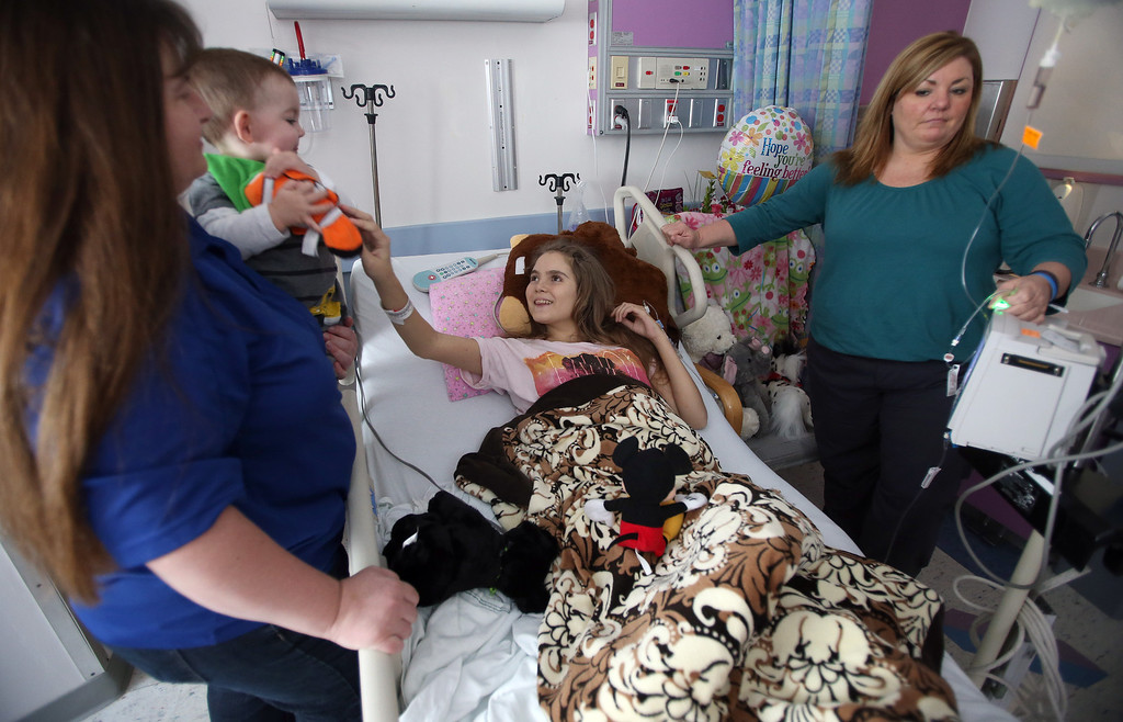 . Alyssa Welch, 15,  of Riverbank, Calif., gets a visit from Kristi Ouimet, left, and her son Matthew, 23 months, of Antioch, at UCSF Benioff Children\'s Hospital in San Francisco, Calif., on Tuesday, Jan. 22, 2013. To the right is Alyssa\'s mom, Kim Welch. Alyssa received a liver and kidney transplant on Jan. 15 and is doing well after surgery.  (Jane Tyska/Staff)