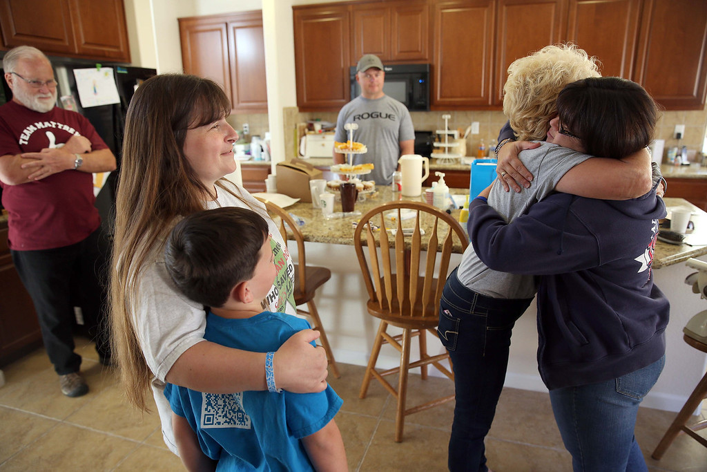. Maggie, right, who preferred not to give her last name, gets a hug from Joyce Wisecarver, Kristi Ouimet\'s mom, left, with son Patrick, 8, at the Ouimet\'s home in Antioch, Calif., on Friday, Oct. 25, 2013. Also pictured are Joyce\'s husband and Kristi\'s father Jim Wisecarver, left, of Antioch, and her brother Jimmy Wisecarver, center, of Brentwood. Maggie\'s son Brandon, 22, died in a car accident and was the donor for Kristi and Kelly Ouimet\'s son Matthew, 2, when he received a liver and kidney transplant at the UCSF Benioff Children\'s Hospital in San Francisco on June 4-5. This was the first time Maggie had met the Ouimet family after recently corresponding on Facebook and through text messages. (Jane Tyska//Bay Area News Group)
