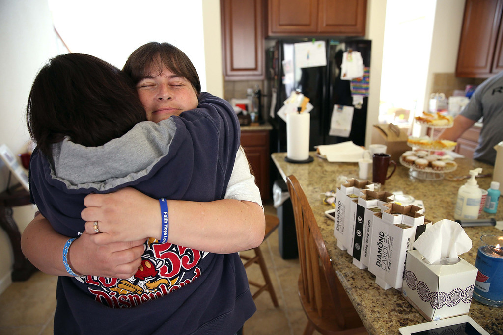 . Kristi Ouimet, right, hugs Maggie, who preferred not to give her last name, at the Ouimet\'s home in Antioch, Calif., on Friday, Oct. 25, 2013. Maggie\'s son Brandon, 22, died in a car accident and was the donor for Kristi and Kelly Ouimet\'s son Matthew, 2, when he received a liver and kidney transplant at the UCSF Benioff Children\'s Hospital in San Francisco on June 4-5. This was the first time Maggie had met the Ouimet family after recently corresponding on Facebook and through text messages. (Jane Tyska//Bay Area News Group)
