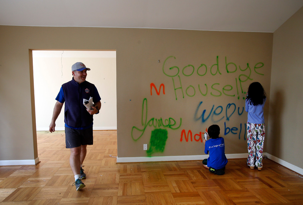 . James Bergeron and his family paint goodbyes on the wall of their home in Menlo Park, Calif., minutes before wreckers demolished it Thursday afternoon, Feb. 27, 2014. It was more cost-effective to build a new house on that lot than to remodel that 67-year-old slab foundation structure. (Karl Mondon/Bay Area News Group)