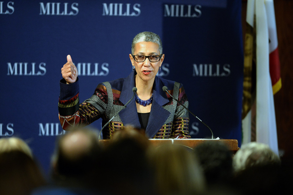 . Alecia A. DeCoudreaux, President of Mills College speaks at a forum on women\'s economic empowerment and unveiling of a commemorative stamp honoring Shirley Chisholm held at Mills College in Oakland, Calif., on Saturday, Feb. 1, 2014. The forum and unveiling featured Mills alum Congresswoman Barbara Lee and Congresswoman Nancy Pelosi, among others. Shirley Chisholm was the first African American elected to Congress. (Dan Honda/Bay Area News Group)