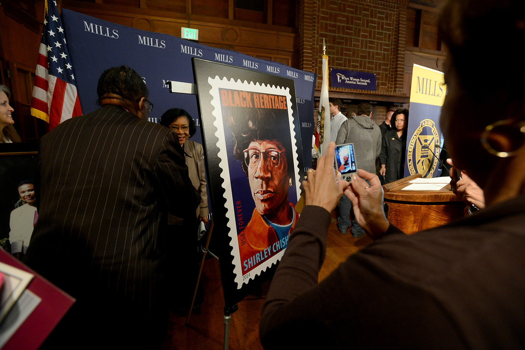 . People take photographs of a likeness of the new Shirley Chisholm stamp unveiled at a forum on women\'s economic empowerment and unveiling of a commemorative stamp honoring Shirley Chisholm held at Mills College in Oakland, Calif., on Saturday, Feb. 1, 2014. The forum and unveiling featured Mills alum Congresswoman Barbara Lee and Congresswoman Nancy Pelosi, among others. Shirley Chisholm was the first African American elected to Congress. (Dan Honda/Bay Area News Group)