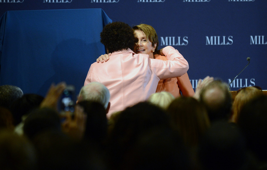 . Congresswoman Barbara Lee, left, hugs Congresswoman Nancy Pelosi, right, at a forum on women\'s economic empowerment and unveiling of a commemorative stamp honoring Shirley Chisholm held at Mills College in Oakland, Calif., on Saturday, Feb. 1, 2014. The forum and unveiling featured Mills alum Congresswoman Barbara Lee and Congresswoman Nancy Pelosi, among others. Shirley Chisholm was the first African American elected to Congress. (Dan Honda/Bay Area News Group)