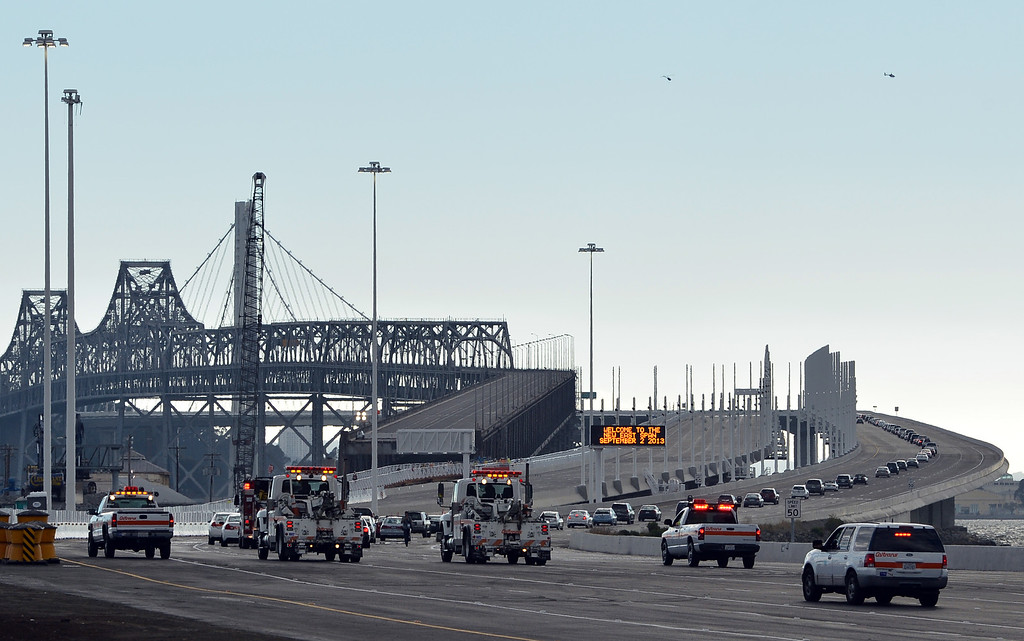 . A line of cars in a ceremonial procession heads up the incline onto the new span of the Bay Bridge following a chain-cutting ceremony to celebrate the completion of the new Bay Bridge in Oakland, Calif., on Monday, Sept. 2, 2013. (Kristopher Skinner/Bay Area News Group)