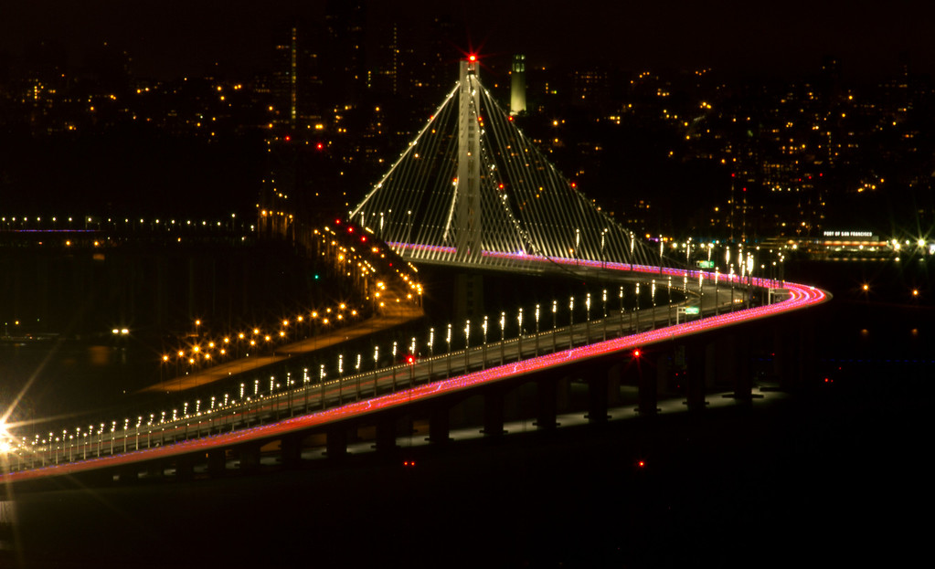 . A line of pink taillights streak across the new east span of the Bay Bridge as it opened to the public, Monday, Sept. 2, 2013 in Oakland, Calif. (D. Ross Cameron/Bay Area News Group)