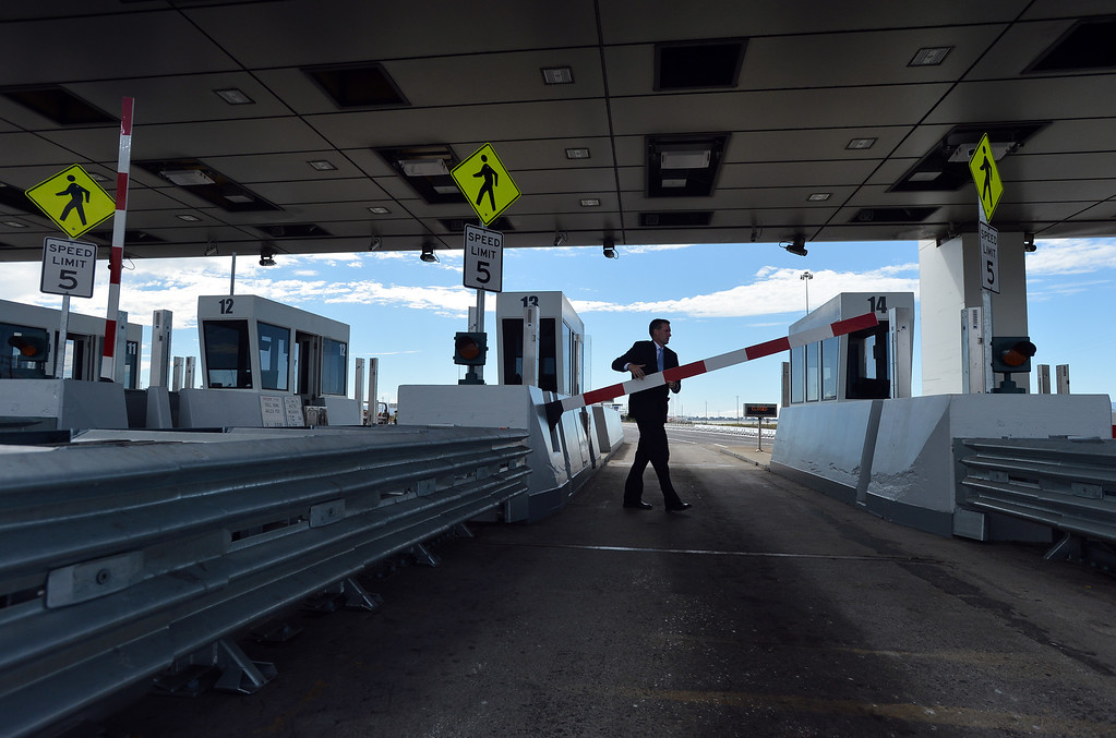 . Jeff Gerbracht, a project manager with the Bay Area Toll Authority, checks the toll plaza gates prior to a chain-cutting ceremony to celebrate the completion of the new Bay Bridge in Oakland, Calif., on Monday, Sept. 2, 2013. (Kristopher Skinner/Bay Area News Group)