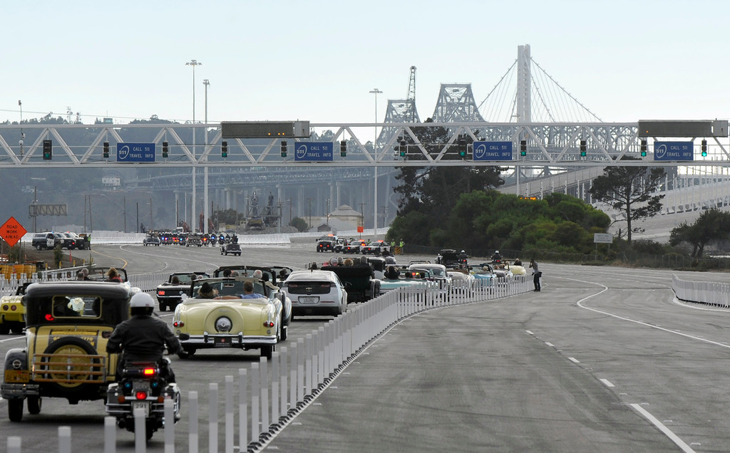 . Classic cars travel onto the new eastern span of the Bay Bridge in Oakland, Calif., on Monday, Sept. 2, 2013. The new 2.2 mile replacement eastern span with its skyward and iconic white tower and cables, is the world\'s largest self-anchored suspension span and California\'s most expensive infrastructure project to date. (Susan Tripp Pollard/Bay Area News Group)