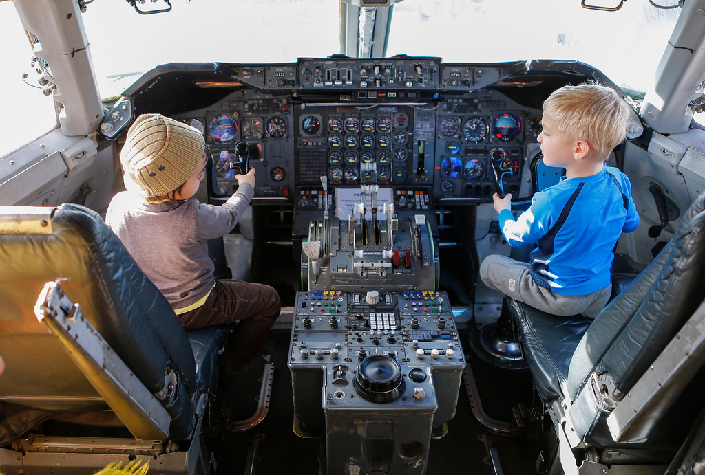 . Nikolai Turienzo Otero, left, and Noah Fishman, right, both 4, sit in the cockpit of a Boeing 747 at the Hiller Aviation Museum in San Carlos, Calif., on Saturday, Jan. 4, 2014. Hundreds of people came out for Open Cockpit Day and got a chance to sit in the cockpit of many of the aircraft on display at the museum. (John Green/Bay Area News Group)