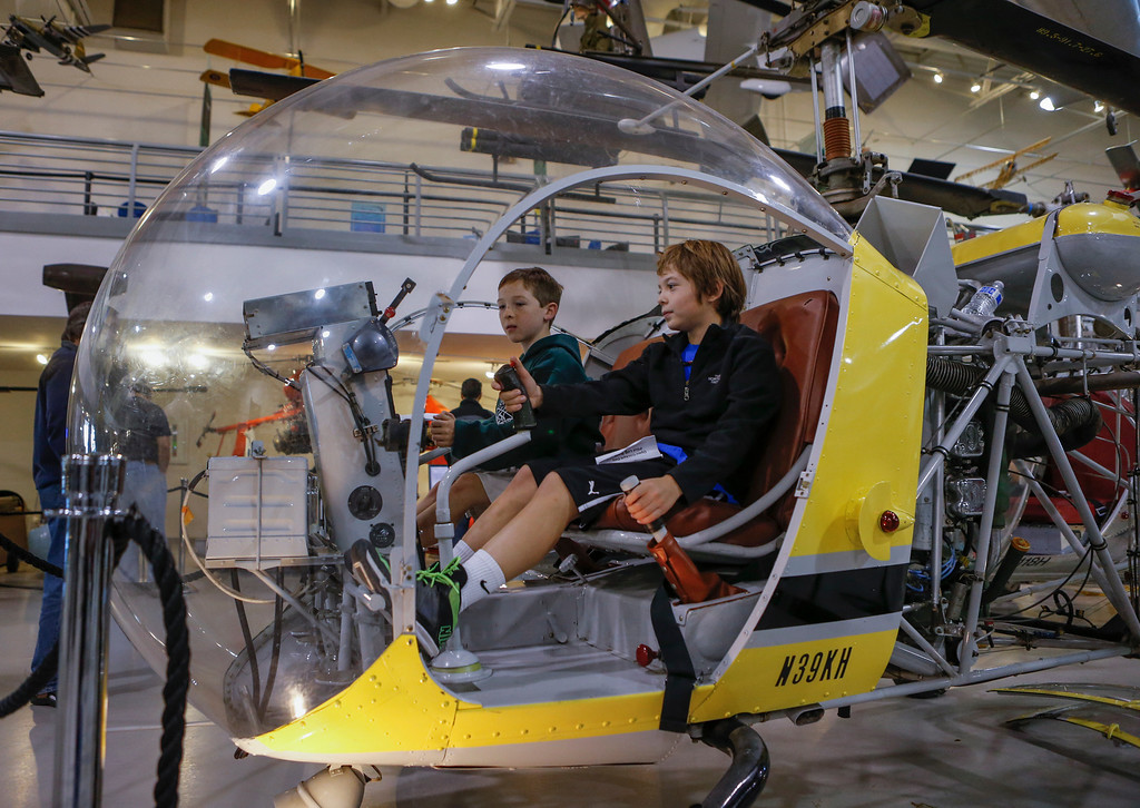 . Robby McKale, left, 10, and Ben Dowler, right, 9, sit in the cockpit of a Bell 47D helicopter at the Hiller Aviation Museum in San Carlos, Calif., on Saturday, Jan. 4, 2014. Hundreds of people came out for Open Cockpit Day and got a chance to sit in the cockpit of many of the aircraft on display at the museum. (John Green/Bay Area News Group)