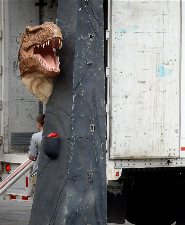 """. A display is placed outside a truck after being unloaded in preparation for the Jurassic Quest held this weekend at the Alameda County Fairgrounds in Pleasanton, Calif., on Thursday, Feb. 6, 2014. The indoor exhibit features  life-size, ultra-realistic animatronic dinosaurs from the Jurassic, Triassic and Cretaceous periods. Visitors can interact with the dinosaurs and learn about them and even ride a few. There will be a T-Rex and Triceratops fossil digs where young paleontologists can uncover long hidden dinosaurs bones. Their is also a \""""Dino Bounce\"""" children\'s play area with several, towering, dinosaur theme inflatable mazes. (Doug Duran/Bay Area News Group)"""