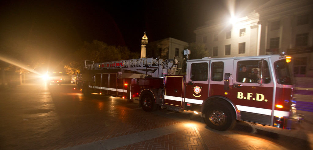 . A trio of fire trucks drive through Sproul Plaza at the University of California after an explosion and fire in an underground utility vault caused a power outage and forced the evacuation of the campus, Monday, Sept. 30, 2013 in Berkeley, Calif. (D. Ross Cameron/Bay Area News Group)