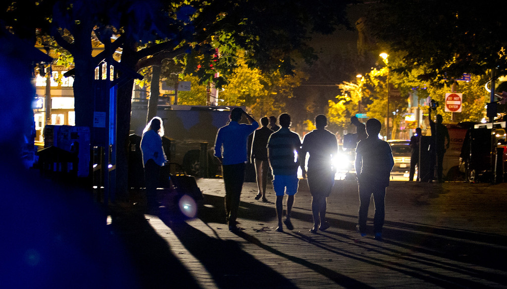 . Unidentified students of the University of California walk back toward Telegraph Avenue after an explosion and fire in an underground utility vault caused a power outage and forced the evacuation of the campus, Monday, Sept. 30, 2013 in Berkeley, Calif. (D. Ross Cameron/Bay Area News Group)