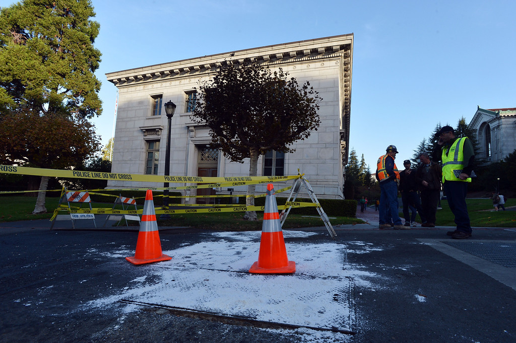 . Crews assess the scene of an electrical fire at UC Berkeley in Berkeley, Calif., on Tuesday, Oct. 1, 2013. The Monday evening fire caused an extensive power outage with many buildings still closed on Tuesday. (Kristopher Skinner/Bay Area News Group)