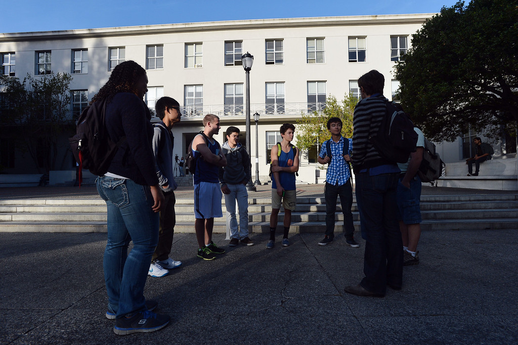 . UC Berkeley students gather outside Dwinelle Hall after finding it closed the morning after an electrical fire at UC Berkeley in Berkeley, Calif., on Tuesday, Oct. 1, 2013.  (Kristopher Skinner/Bay Area News Group)