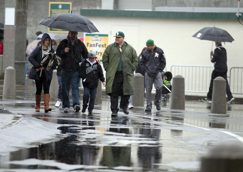 . Oakland Athletics fans arrive in rain outfits for the Oakland A\'s Fanfest 2014  at O.co Coliseum in Oakland, Calif., on Saturday, Feb. 8, 2014. (Ray Chavez/Bay Area New Group)