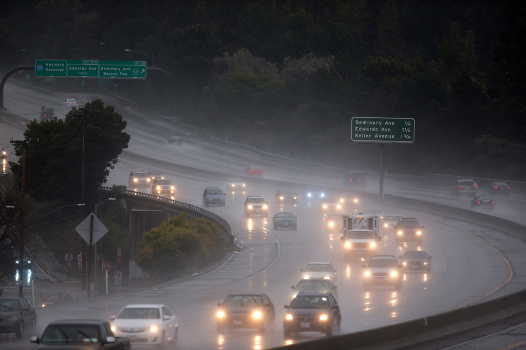 . Cars negotiate rain-soaked Interstate 580 in Oakland, Calif., on Sunday, Feb. 9, 2014, as rain fell for a third straight day -- the first significant rainfall in the region since the beginning of December 2013. (D. Ross Cameron/Bay Area News Group)