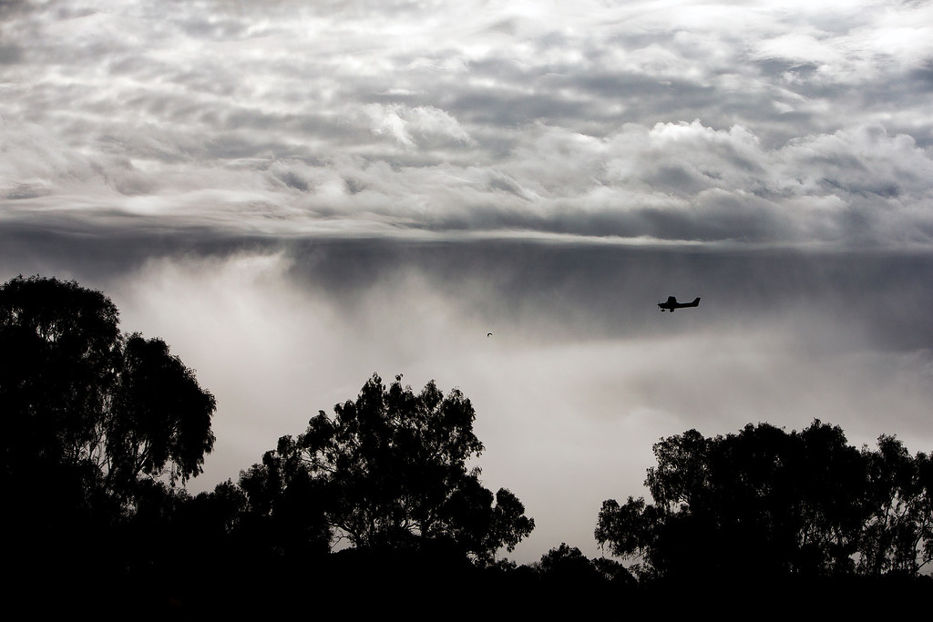 . A plane takes off from the Palo Alto Airport of Santa Clara County over cloudy skies in Palo Alto, Calif., on Saturday., Feb.8, 2014.   (LiPo Ching/Bay Area News Group)