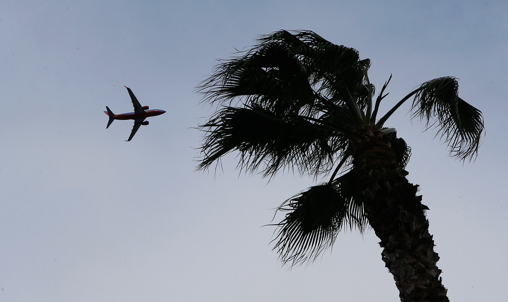 . Because winds were coming from the south, planes took off opposite of their normal direction in San Jose, Calif., on Sunday, Feb. 9, 2014. While the sky was full of rain clouds, very little rain made it to the ground during the day. (Jim Gensheimer/Bay Area News Group)