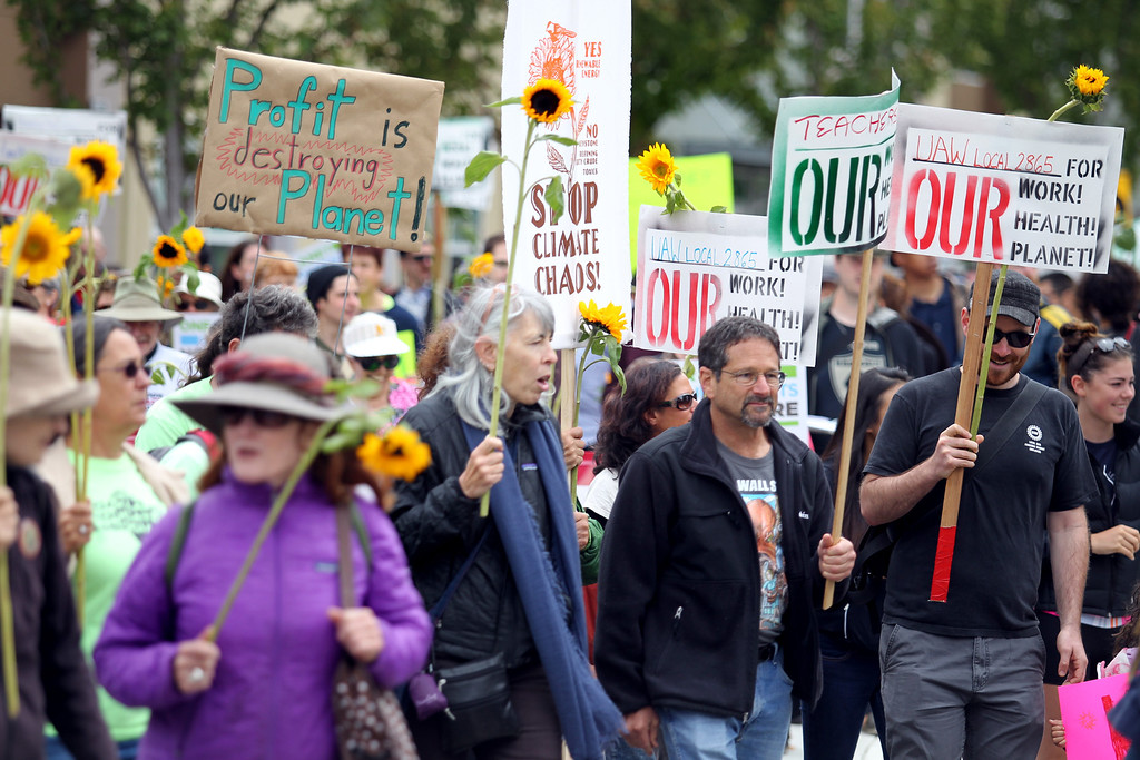 . About 500 demonstrators march to the Chevron refinery after a rally at Richmond BART station in Richmond, Calif., on Saturday, Aug. 3, 2013.  (Ray Chavez/Bay Area News Group)