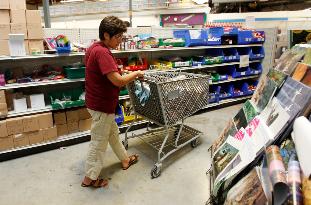 . Barron Park Elementary Principal Magdalena Fittoria goes down an aisle looking at supplies for the school year at Resource Area For Teaching in San Jose, Calif., on Saturday, Aug. 10, 2013. (Josie Lepe/Bay Area News Group)