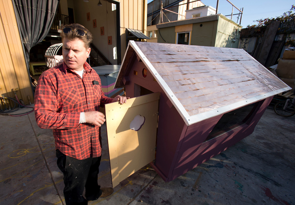 . Gregory Kloehn of Oakland, shows off some of the makeshift rolling shelters for the homeless that he has built out of garbage dumped in his West Oakland neighborhood, Thursday, Dec. 19, 2013. (D. Ross Cameron/Bay Area News Group)